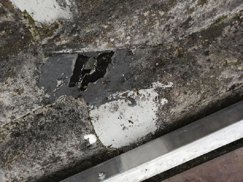 Asbestos roof traffic damage